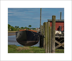 Just add water (prendergasttony) Tags: nikon d7200 water estuary wyre river outdoors boat jetty moored logs rope sky clouds blue lancashire nature geometric hull shape perched balanced tiedup