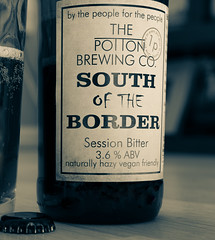 Close Up - Label - Bottle of South of the Border ( a 3.6% red Bitter from the Potton Brewery) (Split Tone Effect) (Panasonic S1 & Lumix S 24-105mm f4 Zoom) (1 of 1) (markdbaynham) Tags: beer cerveza birra ale bitter drink label closeup panasonic s1 panasonics1 lumix lumixszoom lumixs1 lumixer 24105mm 24105mmf4 panasoniczoom dmcs1 ff fullframe fullframemirrorless panasonicfullframe mirrorless mirrorlesscamera mirrorlessfullframe pottonbrewery bottle
