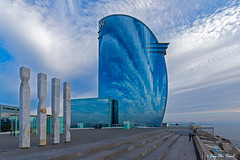 Hotel W (McGuiver) Tags: canon canon7dmarkii canon1022 barcelona hotelw arquitectura architecture forms blue clouds reflections