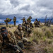 U.S. Marines prepare for a dose of compound 2-chlorobenzalmalononitrile