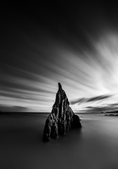 The Rock (One_Penny) Tags: stefanklauke canon6d photography spain longexposure water sky clouds rock blur shutterspeed black white dark sinister moody dramatic contrast coast landscape seascape waterfront shore tide hightide seaside minimal light morning