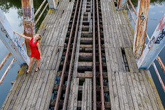 Ania from drone (piotr_szymanek) Tags: drone portrait outdoor landscape woman young skinny face ania aniaz red dress water river channel rail bridge blue 1k 20f 50f 5k