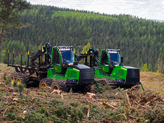 Brothers. (HivizPhotography) Tags: john deere 1110g 1910g forwarder forest forestry clearing logs timber scotland industry heavy green iron wood woodland chains wheeled