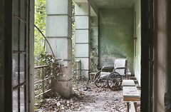 Ospedale V (Sean M Richardson) Tags: abandoned hospital wheelchair nature decay texture details leaves reflection italia italy travel explore urbex canon photography classic green color light 50mm