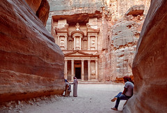 The Treasury in Petra (liseykina) Tags: petra jordan ancient stone city rock travel desert sandstone canyon facade unesco architecture archeology world history east bedouin view arab red mountain culture landmark heritage carved tomb cave house beduin man people nabataean bdoul kazheh alkhazneh thetreasury temple siq original big stock