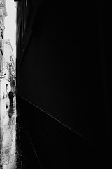 Swallowed by Darkness (elgunto) Tags: barcelona streets streetphotography people silhouette monochrome blackwhite bw highcontrast light lines perspective architecture sonya7 voigtlander21mmf35e colorskopar