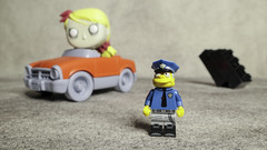 Officer Wiggum has his eye on Traffic (DayBreak.Images) Tags: tabletop toys lego miniature funkopop greentoys car canoneosm mirrorless opteka 15mmf4macrolens ringlight lightroom home