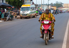 African man riding a motorbike in the street, Poro region, Korhogo, Ivory Coast (Eric Lafforgue) Tags: adults africa africanethnicity city colourimage côtedivoire fulllength groupofpeople horizontal ivorycoast ivory5511 korhogo men motorbike motorcycle outdoors photography pororegion riding senoufo senufo street town transportation travel westafrica
