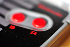 Gameboy Advance NES Classic Controller Buttons (Martyn.Hayes) Tags: stilllife retro retrogames 2000s 1980s 1990s videogames games gamer ninteno mario supermario nintendoentertainmentsystem gameboy gameboycolour gameboyadvance gba electronic handheld system closeup macro bokeh buttons red aandb controller joypad