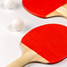 Two rackets for playing table tennis on white background