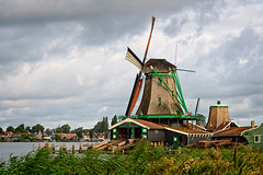 Lumber Windmill (Brett of Binnshire) Tags: historicalsite zaandam netherlands clouds river locationrecorded water on1raw architecture windmill manipulations weather museum zaanseschans stream northholland