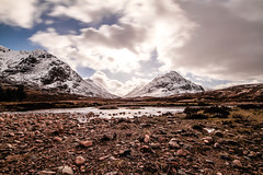 Over sticks and stones (NikNak Allen) Tags: scotland scottish highlands scottishhighlands glencoe etive mor glenetive river water mountain range mountains winter snow cold sky cloud clouds longexposure low pov view landscape herdsman sun light