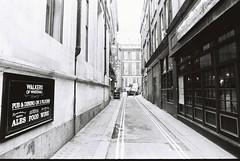 London (goodfella2459) Tags: nikonf4 afnikkor24mmf28dlens ilfordhp5plus400 35mm blackandwhite film analog city london streets alley buildings sign road car people pedestrians bwfp