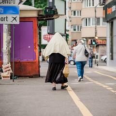 (Brînzei) Tags: bucurești canonfd canonfd85mmf18ssc fujifilmxt1 mitakon zhongyilensturboii bokeh candid manualfocus motion nofaces people rain squareformat street walking women ștefancelmare