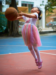 4-6 Yr Old Basketball English Lesson 11 (ArdieBeaPhotography) Tags: boy girl child kids children kindergarten preschooler elementary school age play basketball shoot throw catch pass toss ball leap jump tights white rainbow gauzy skirts trousers shorts shirt tshirt blue glasses court trees shadow leaves tummy navel button bare exposed sandals trainers shoes trackpants outside class learning teaching englishlesson black hair cute pretty beautiful handsome enthusiastic game energetic excited together tamronspaf2875mmf28xrdildasphericalif