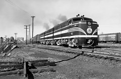 Lehigh & New England Railroad ALCO FA-1's & FB-1 in a ABA lash-up led by # 710, along with its manifest freight train, are seen while passing through the New Haven Railroad Yard at Maybrook, New York, ca 1950 (alcomike43) Tags: lehighnewenglandrailroad lne trains freighttrains manifestfreighttrains railroads yard maybrooknewyork boxcars freightcars tracks rails ties rightofway roadbed ballast jointedsectionrail switch turnout tieplates spikes anglebars mainline railroadfacility buildings house ncstl nashvillechattanoogasaintlouis engines locomotives diesels alco engineer people fa1 fb1 aba 701 dieselengine diesellocomotive dieselelectriclocomotive photo photograph negative bw blackandwhite old historic vintage classic maybrookyard newhavenrailroad