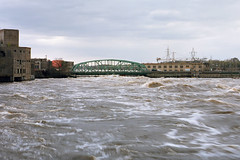 Flood waters in Ottawa (Howard Sandler (film photos)) Tags: flood water river rapids waves bridge chaudiere ottawa canada spring roiling disaster nikon fm nikkor portra film