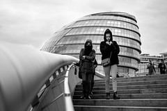 London, City Hall, May (Silver Machine) Tags: london cityhall streetphotography street people walking steps girl cold furcoat hood blackwhite bw mono monochrome fujifilm fujifilmxt10 fujinonxf35mmf2rwr