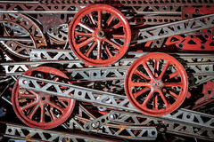 Old, dusty round gear wheels from an antique erector set (ShebleyCL) Tags: gears wheels erectorset retro vintage toy dusty steampunk red