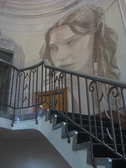 The Stairwell Portrait of Lily Sullivan - Rone Empire Installation Exhibition; Burnham Beeches, Sherbrooke (raaen99) Tags: roneempire roneempireexhibition rone tyronewright portrait lilysullivan painting streetart empireexhibition roneempireinstallation empireinstallation art artinstallation artexhibition installation exhibition burnhambeeches dandenongranges dandenongs victoria australia sherbrooke burnhambeechesmansion burnhambeechessherbrooke melbourne artdeco deco interior artdecointerior graffiti graffitiart ephemera ephemeral temporary decaying decayed harrynorris architecture architecturallydesigned artdecobuilding artdecomansion artdecohouse streamlinemoderne streamlinemodernearchitecture streamlinemodernehouse streamlinemodernemansion artdecoarchitecture alfrednicholas decay stairwell staircase atrium balustrade wroughtironbalustrade wroughtiron artdecowroughtiron balcony balconette chandelier pillar steps flightofstairs flightofsteps stairs sweepingstairs sweeping staircasevenusstatuevenus de milovenus milo statuefemale statue statuette