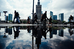 Countless lovers under cover of the street (ewitsoe) Tags: city nikond750 spring street warszawa erikwitsoe urban warsaw palaceofcultureandscience pkin streetreflection cityscape people crowd move polska everydaylife rain weather water standing towers skyscrapers skyline