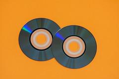 Mini disc isolated against orange background (Rushay) Tags: disc storage compact isolated mini orange technology portelizabeth southafrica