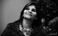 Moment (Rudr Peter | Smile to the world |) Tags: pratibha rudrpeter bw portrait shot outdoor headshot neckalace lookingup moment garden background mood happy indian lady woman mother
