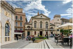 Town Hall Square, Corfu. (clive_metcalfe) Tags: corfu corfutown greece greek buildings steps flags cloud sky lamppost balcony shutters people