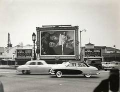 Wilshire and Fairfax Boulevards (jericl cat) Tags: losangeles neon sign boulevard wilshire fairfax advertisment ad corner salome movie ritahayworth stewartgranger geller screen radio drama school theatre theater streetlight painting frame 1953