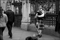 Piper at the Gates of Parliament - DSCF0801a (normko) Tags: london westminster parliament piper bagpipes musician street performer kilt scottish