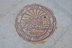 Sewer Cover, Omaha, NE (Robby Virus) Tags: omaha nebraska ne sewer metal access manhole cover street cement