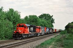 CN 5132 east in Onalaska, Wisconsin on May 16, 1993. (soo6000) Tags: potash railroad train manifest freight unittrain onalaska wisconsin cn760 760 bn trackagerights stcroixsub cn 5132 sd40 emd standardcab
