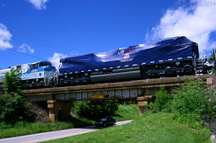 """Powered by Our People"" in Transit (Jeff Carlson_82) Tags: up 1111 4141 paola ks mnlkc tarped georgehwbush poweredbyourpeople unionpacific emd sd70ace tarp kansas bridge coffeyvillesub employees commemorative locomotive train railroad railfan railway"
