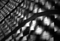 Lights on Facade Peaks (HWHawerkamp) Tags: leipzig germany abstract architecture pattern bw light shadow facade scales shapes wall
