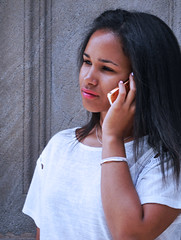 Nothing goes without a cell phone (chrisk8800) Tags: youngwoman girl mobilephone portrait street barcelona candid