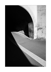 Simple Passage (Thomas Listl) Tags: thomaslistl blackandwhite biancoenegro noiretblanc monochrome graphical 35mm shadow light lightandshadow contrast passace tunnel arch lines geometry geometric stone