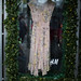 H&M advert at tram stop. Dress sealed in glass
