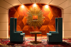 A Formal Conversation seating area (Gentilcore) Tags: 3d architecture area art blue classic conversation formal front gold lit old radiant sun two wood artdeco back beam chairs circle couple cube cubic cubism deco design designed dimensional elements facing interior leather lounge mirror pair panel radiating romantic round seating studded style sunburst table three vintage wall wing wingback