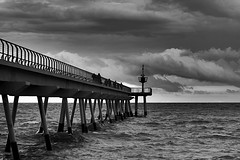While the moon was refusing to come out (Fnikos) Tags: sea water mar mare ocean wave wind pier pont puente seascape architecture dark light lighthouse bay sky skyline cielo cloud clouds cloudy shadow shadows people walk blackandwhite monochrome absoluteblackandwhite outside outdoor