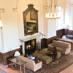 Cozy in a Big Way (Melinda * Young) Tags: interior fireplace couches sitting warm cozy lounge ihouse berkeley international residence campus uc wroughtiron mirror carpet persian light fixtures chandelier