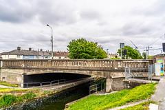 MANY DUBLINERS MAY BE UNAWARE THAT THE GRAND CANAL FORKED HERE [AT SUIR ROAD BRIDGE]-152758 (infomatique) Tags: grandcanal mainline circularline canallocks davittroad suirroad suirroadbridge grandcanalharbour jamessstreet anndevlin annedevlin dolphin'sbarn portobello dublin4 riverliffey luas redline publictransport tramline griffithbridge firstlock 7thlock canals bridges williammurphy infomatique fotonique sony a7riii zeissbatis batis zeiss 25mmlens ireland