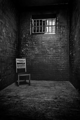 Solitary (Mister Oy) Tags: solitary confinement cell room prison chair mono monochrome blackandwhite nikond850 nikon2470mmf28evr bars window jail gaol punish punishment