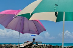 the Power of Three (Little Hand Images) Tags: umbrellas beachumbrellas lifeguard three rockjetty water sky clouds sunny vacation cruise bahamas princesscay