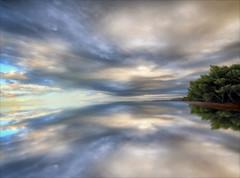 Il Custode dei Sogni (Gio_guarda_le_stelle) Tags: seascape sea seaside clouds sky dream trees horizon orizzonte quiet atmosphere favola fairytales 4 artwork reflection hope open spazio light luce