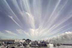 Moss Landing Sky Burst (waves_and_wonders) Tags: monterey bay blue nautical sea ocean coast coastal photography art fineart waves water beach sky nature clouds california central centralcoast mosslanding harbor boat seascape seascapes landscapes outdoors
