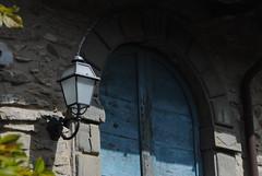 Il Glicine e La Lanterna (Elizabeth Almlie) Tags: italy toscana tuscany vignola agriturismo ilglicineelalanterna door blue lamp lantern shadow