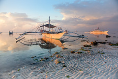 Boats on a tropical beach at sunrise (liseykina) Tags: beach tropical boat sea landscape island ocean sky summer travel water coast trip nature blue vacation sand shore bay paradise beautiful view asia seascape wooden fishermans philippines panglao alonabeach sunrise morning nobody tranquil calm reflection beachtropicalboatsealandscapeislandoceanskysummertravelwatercoasttripnaturebluevacationsandshorebayparadisebeautifulviewasiaseascapewoodenfishermansphilippinespanglaoalonabeachsunrisemorningno original big stock