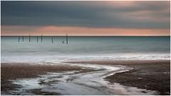 Rockanje Beach (Rob Schop) Tags: beach seascape lowtide tele longexposure sony55210oss sonya6000 sunset cloudy multipleexposure fishingnet foreground zuidholland