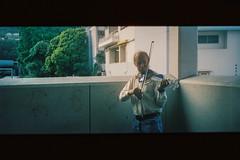 Violinist in Kowloon (justus9427) Tags: film cinestill street hk night people life light