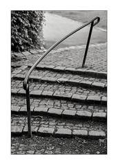 Railing and stair (K.Pihl) Tags: olympusom1 railing monochrome stairs zuiko85mmf20 cobblestones film pellicolaanalogica schwarzweiss bw kodaktmax400 analog blackwhite